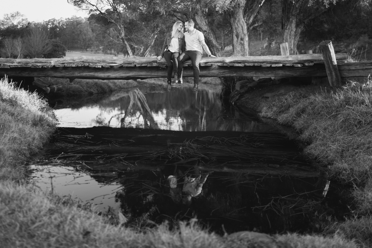 009_cute couple on bridge in wollombi for engagement photography