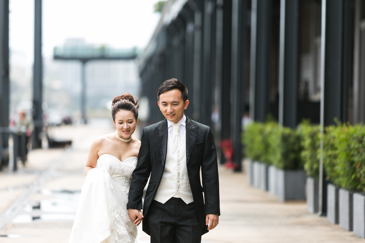 Candid shot of the bride and groom walking hand in hand at The Rocks in Sydney wedding photographer