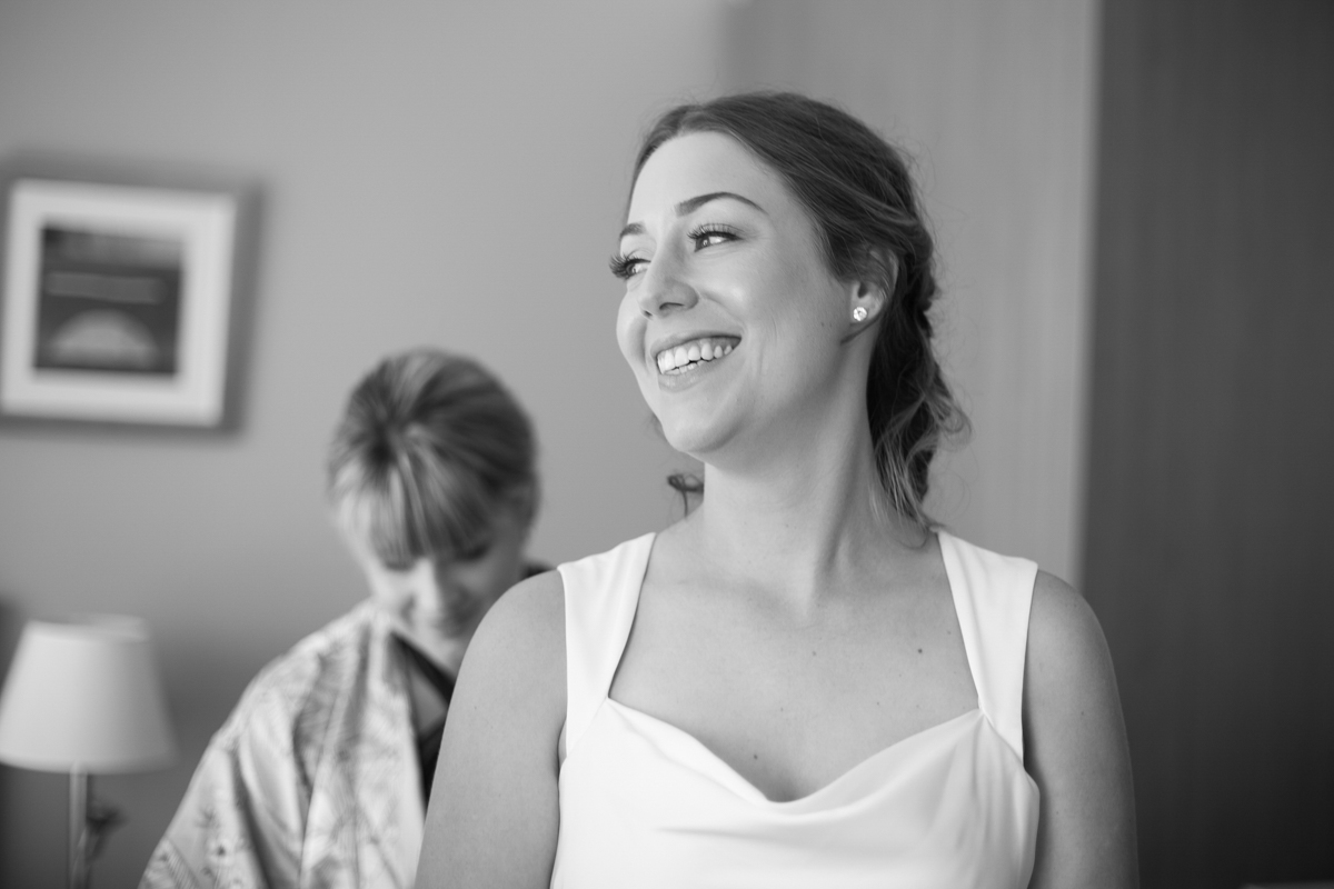 04_happy bride at crowne plaza newcastle with candid wedding photographer