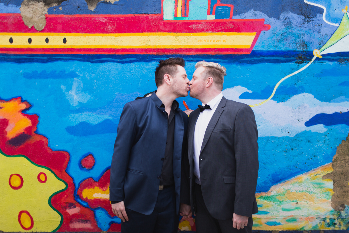 05_gay wedding photographer captures gay men kissing for awesome photo shoot at bar beach