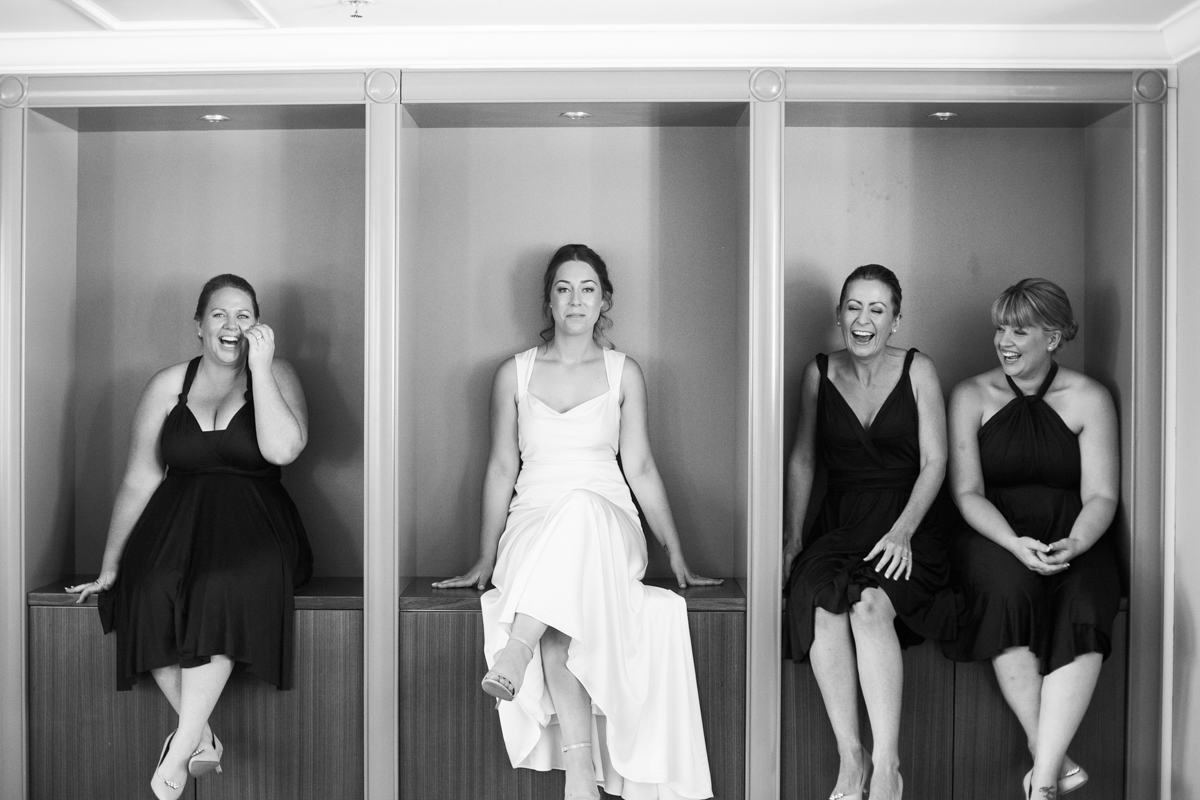05_happy bridesmaids at crowne plaza newcastle captured by relaxed wedding photographer