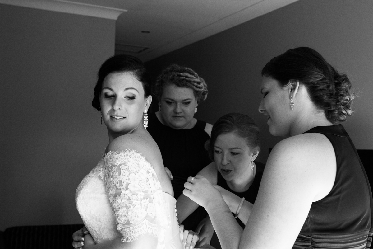 07_bride getting ready with bridesmaids at crowne plaza with wedding reportage