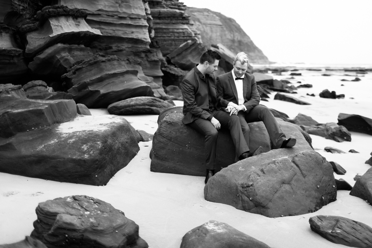 11_Gay couple share sweet moment at Susan Gilmore beach captured by newcastle wedding photographer
