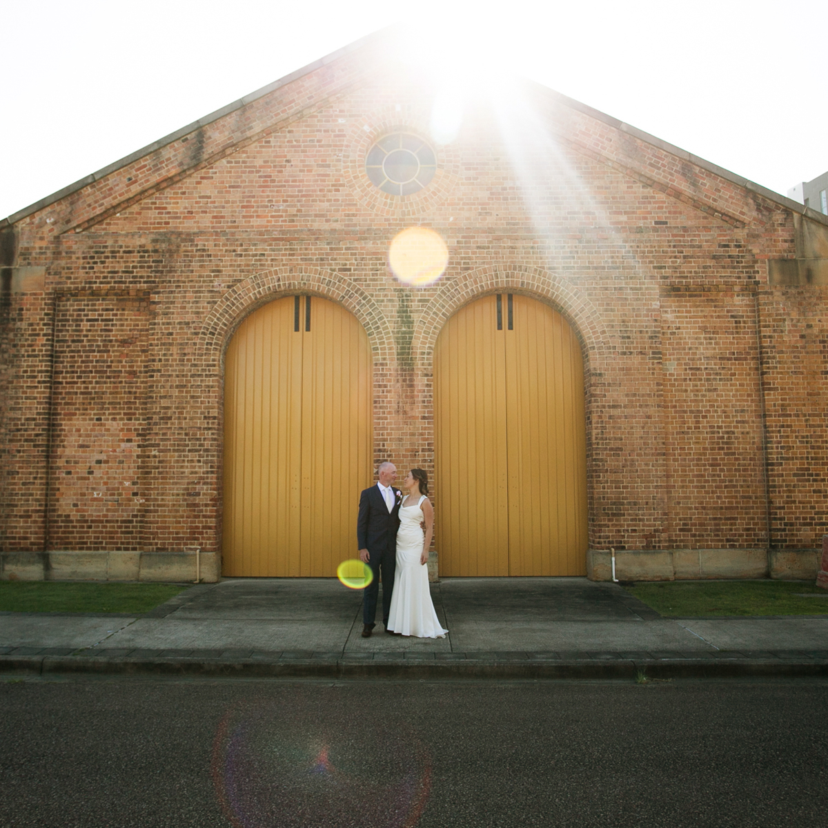 14_newcastle wedding photographer with bride and groom at train sheds in honeysuckle