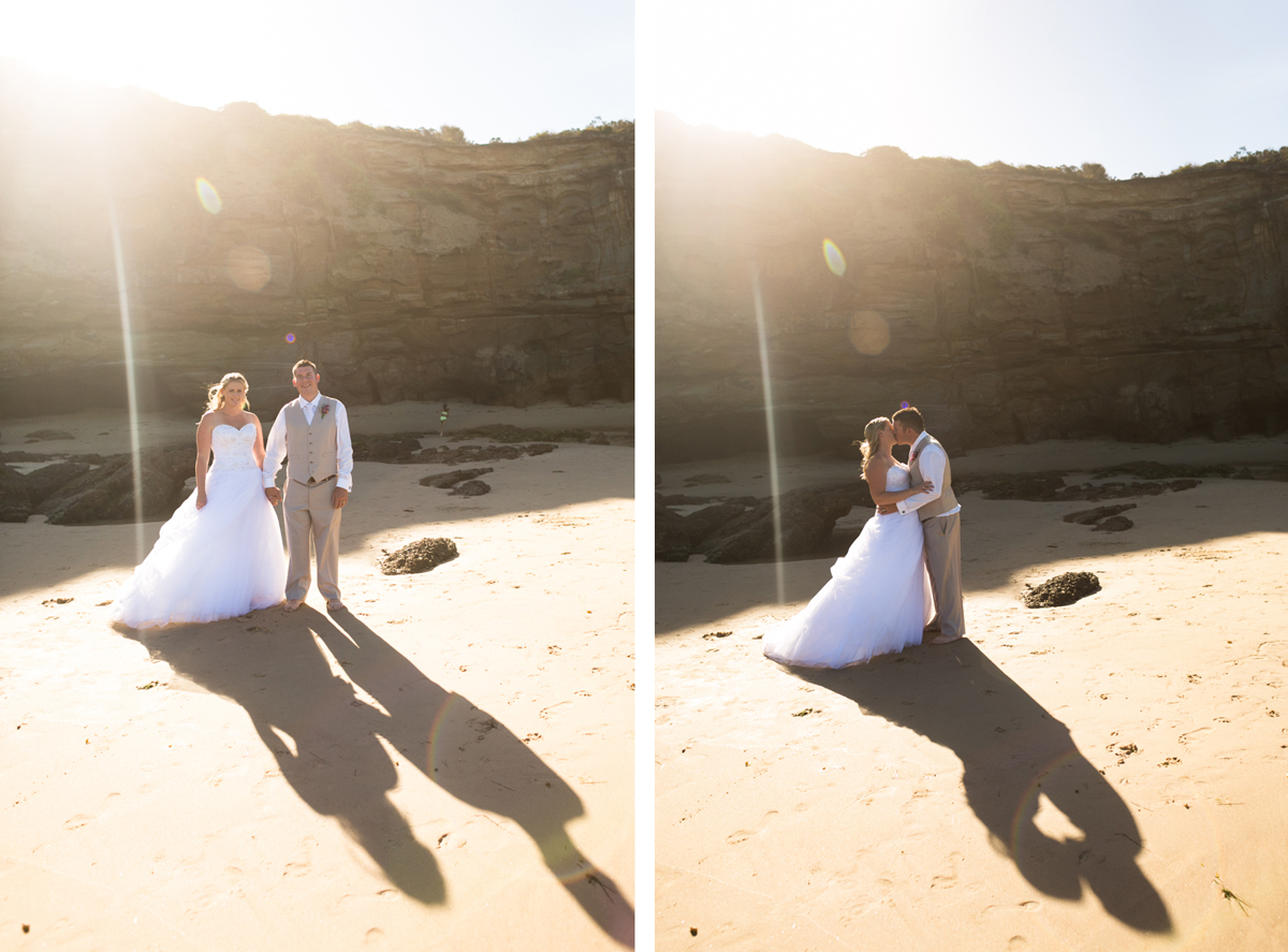 Dual shot of the bride and groom standing on the beach in front of caves and cliff faces with sun streaming in behind them Caves Beach wedding photography