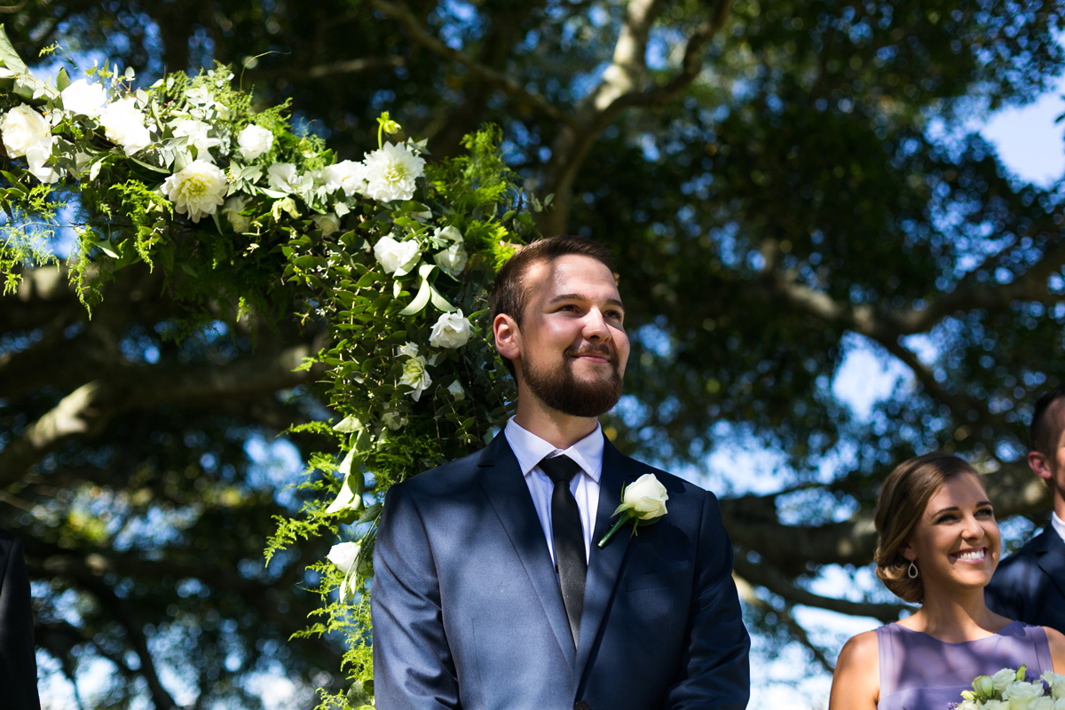 Reaction shot of the groom seeing the bride walking down the aisle for the first time Tocal Homestead wedding photographer