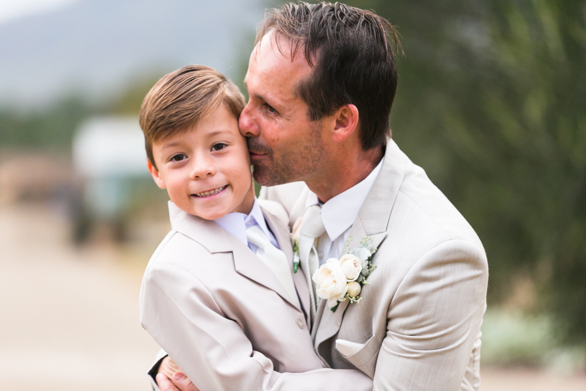20_groom with paige boy at margan wines hunter valley wedding photographer