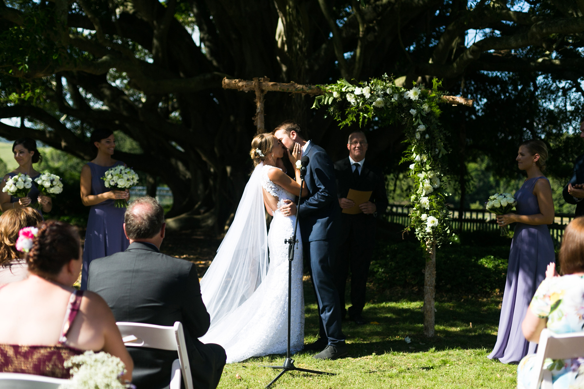 The bride and groom kiss for the first time as husband and wife Tocal Homestead wedding photographer
