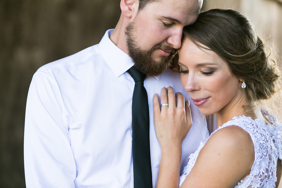 Close up of the bride and groom cuddling Tocal Homestead wedding photographer