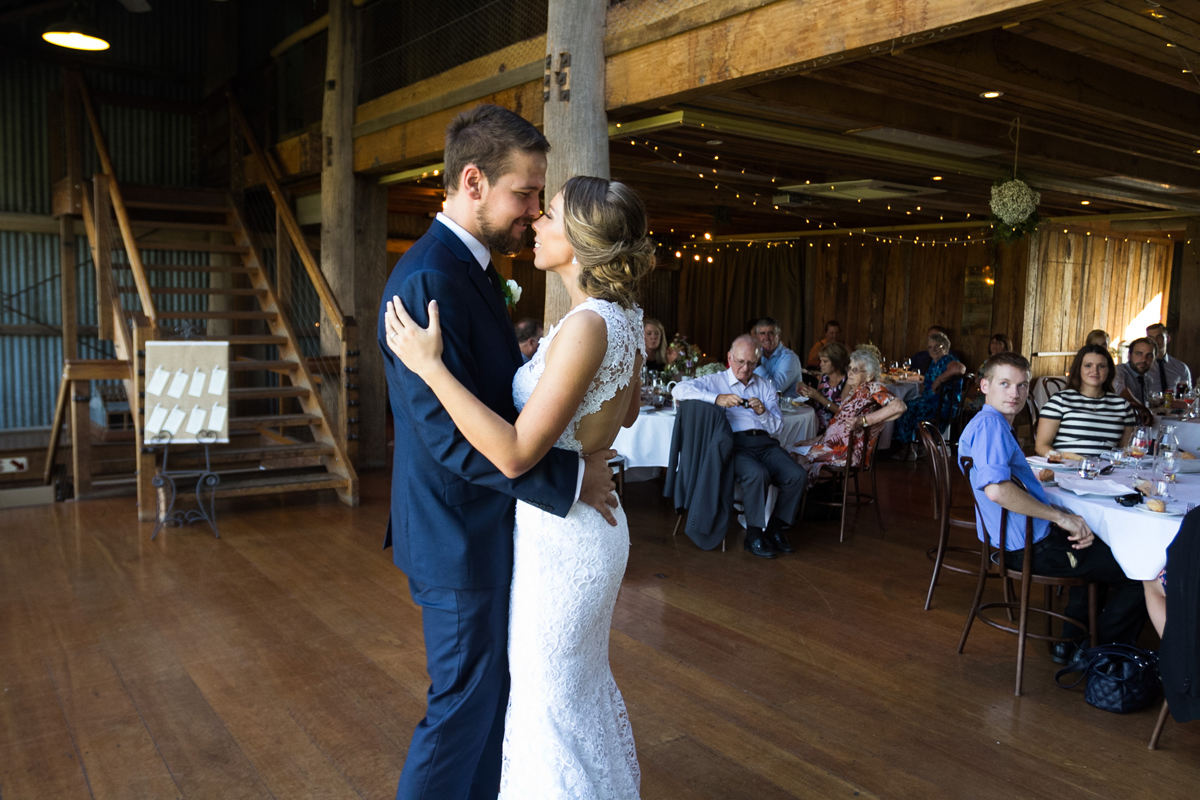 The bride and groom stare into each other's eyes during their first dance Tocal Homestead wedding reception photographer